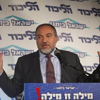 Avigdor Lieberman has announced he is resigning as Israeli foreign minister (AP)
