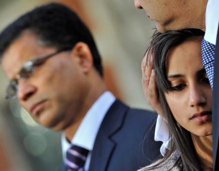 Jacintha Saldanha's daughter Lisha (R) and widower Ben Barboza (L) give a news statement outside of Westminster Cathedral following a memorial service in London December 15, 2012. The family of a nurse who apparently committed suicide after taking a prank call at the hospital treating Prince William's pregnant wife Kate delivered a tearful tribute to her on Saturday, saying her death had left