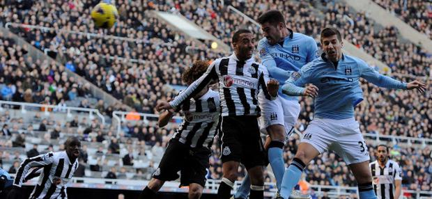 Manchester City's Javi Garcia (2nd R) heads to score against Newcastle United during their English Premier League soccer match in Newcastle, northern England December 15, 2012. REUTERS/Nigel Roddis (BRITAIN - Tags: SPORT SOCCER) NO USE WITH UNAUTHORIZED AUDIO, VIDEO, DATA, FIXTURE LISTS, CLUB/LEAGUE LOGOS OR