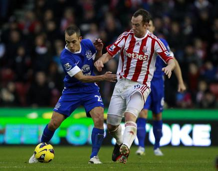 Stoke City's Charlie Adam (right) and Everton's Leon Osman battle for the ball during the Barclays Premier League match at the Britannia Stadium, Stoke. PRESS ASSOCIATION Photo. Picture date: Saturday December 15, 2012. See PA story SOCCER Stoke. Photo credit should read: Dave Thompson/PA Wire. RESTRICTIONS: Editorial use only. Maximum 45 images during a match. No video emulation or promotion as 'live'. No use in games, competitions, merchandise, betting or single club/player services. No use with unofficial audio, video, data, fixtures or club/league logos.