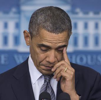 President Barack Obama wipes his eye as he talks about the Connecticut elementary school shooting (AP)