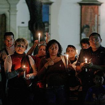 People hold candles during a vigil in support of Venezuela's President Hugo Chavez in Caracas (AP)