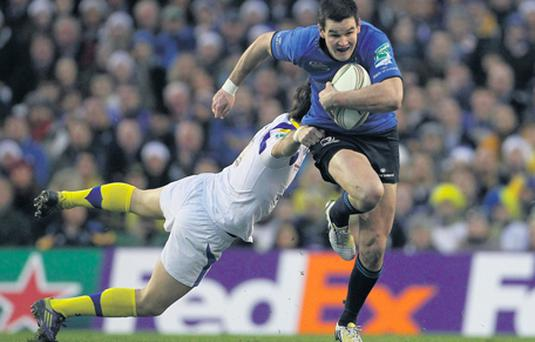Leinster's Jonathan Sexton gets away from the tackle of Clermont Auvergne's Morgan Parra during the Heineken Cup encounter at the Aviva Stadium.