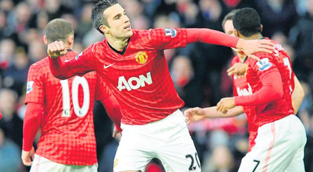Manchester United's Robin van Persie (centre) celebrates scoring their first goal during the Premier League match against Sunderland at Old Trafford yesterday