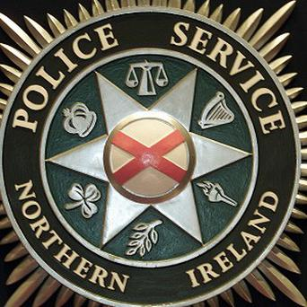 Officers from the PSNI serious crime branch have charged a woman with attempting to possess criminal property and perverting the course of justice