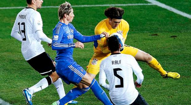 Goalkeeper Cassio of Brazil's Corinthians stops Fernando Torres (2nd L) of Britain's Chelsea from scoring during the FIFA Club World Cup final soccer match in Yokohama