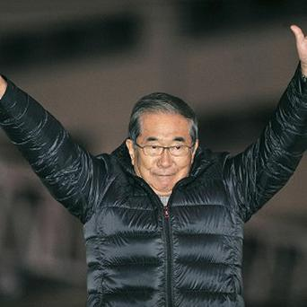 Right-leaning, populist Restoration Party of Japan leader Shintaro Ishihara waves to supporters on the final day of campaigning (AP)