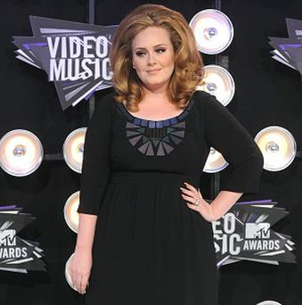 Adele has been named Billboard's artist of the year 2012