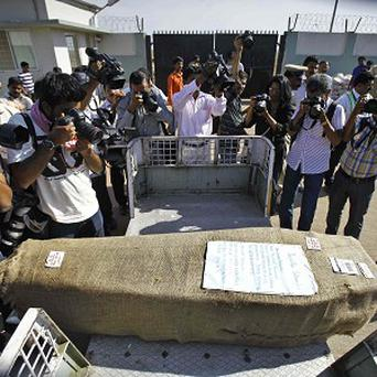A casket containing the body of Jacintha Saldanha, a nurse found hanging in her room days after she had been duped by a hoax call (AP)