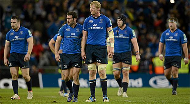 Disappointment is etched upon the faces of Leinster players (l-r) Cian Healy, Fergus McFadden, Leo Cullen, Sean O'Brien and Michael Bent as they leave the pitch after losing to Clermont
