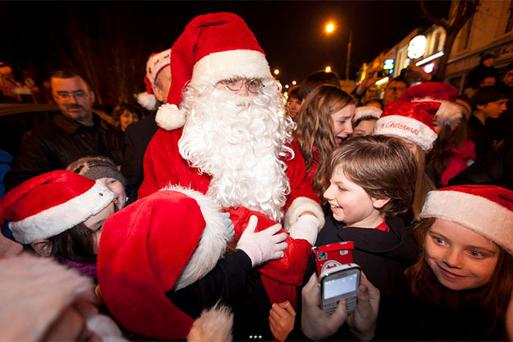 Santa arrives in Newbridge to turn on the Christmas lights. Photo: Michael Donnelly