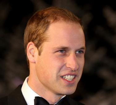 The prince's bald patch is very obvious