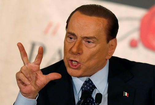 Former Italian prime minister Silvio Berlusconi gestures as he talks during the book launch of his friend, TV presenter Bruno Vespa, in Rome. Photo: Reuters