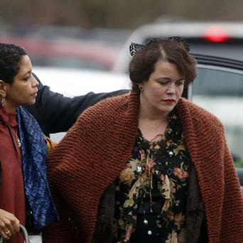 Veronika Pozner, right, arrives at a funeral service for her son Noah in Newtown, Connecticut (AP)