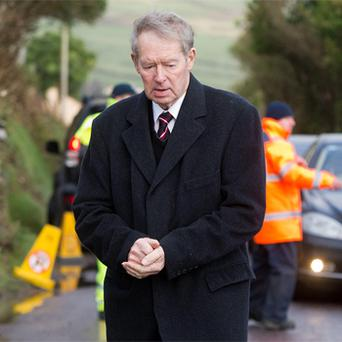 Micheal O Muircheartaigh arriving at the wake for Paidi O Se in Ard a Bhothair, west Kerry. Huge crowds are expected for today's funeral