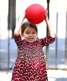 "Suri is only seven but she is incredibly interested in clothes,"" according to a friend."