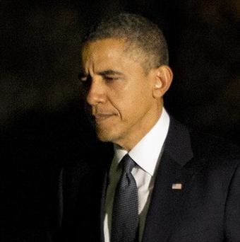Barack Obama is in talks with Republican rivals on avoiding a 'fiscal cliff' (AP/Jacquelyn Martin)