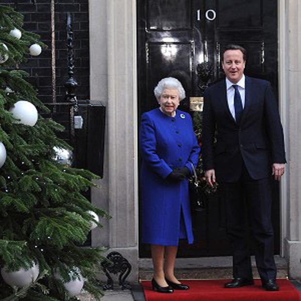 The Queen is met by Prime Minister David Cameron outside 10 Downing Street. File photo