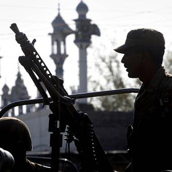A Pakistan soldier on guard against the Taliban in Peshawar (AP)