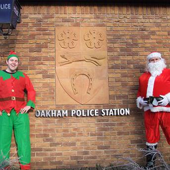 PCSO Jay Cooper (left) and PC Joe Lloyd swapped their uniforms for a Santa Claus outfit and Christmas elf costume