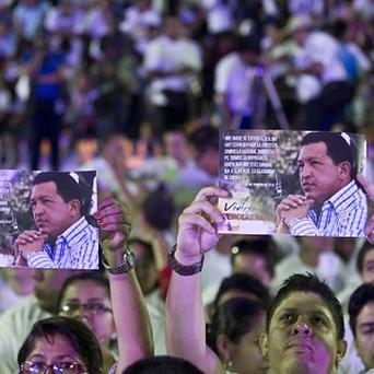 People hold up images of Venezuela's president Hugo Chavez during a concert in support of him in Managua, Nicaragua (AP/Esteban Felix)