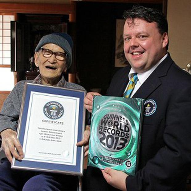 Jiroemon Kimura poses with Guinness World Records editor-in-chief Craig Glenday after becoming the world's oldest person (AP/Kyotango City)