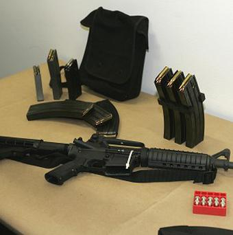 A Bushmaster AR-15 semi-automatic rifle and ammunition (AP/Ted S Warren)