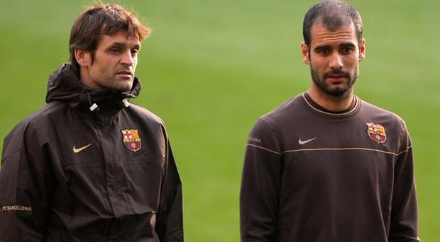 Tito Vilanova (left) with former Barcelona manager Pep Guardiola. Photo: PA