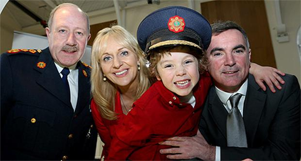 Garda Commissioner Martin Callinan, Miriam O'Callaghan with Aidan and Adam McCabe at Garda HQ