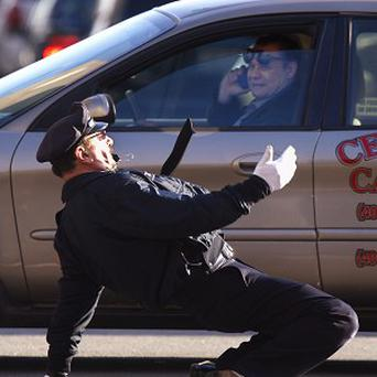 Cop for this - the dancing policeman goes through his moves (AP)