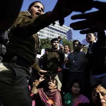 Indian police confront protesters over the bus rape (AP)