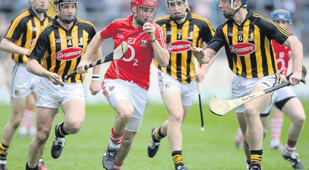 Cork's Luke O'Farrell is pursued by Kilkenny trio Jackie Tyrrell (4), Richie Doyle (7), and Brian Hogan (6) during the National Hurling League final last May