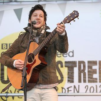 Matt Cardle says his album fared better in the charts than Tulisa's