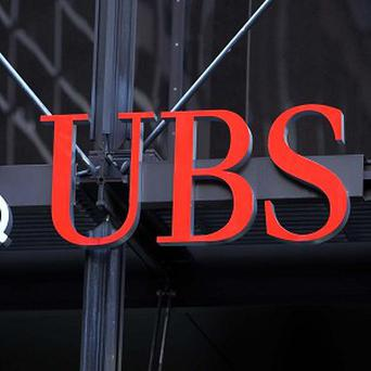 UBS agreed to pay 940 million pounds in fines for trying to manipulate the Libor interest rate