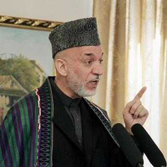 Afghan President Hamid Karzai insisted his forces are ready to take on defence of the country (AP)