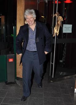 "DUBLIN / IRELAND 20-12-12MEMBERS OF U2 ARRIVING AT HARRY CROSBIE'S "" H CAFE BAR "" FOR THIER CHRISTMAS PARTY FOR THEIR STAFF.BONO,EDGE AND ADAM CLAYTON STOPPED AND POSED FOR PHOTOS AND SIGNED AUTOGRAPHS FOR WAITING FANS WHICH INCLUDED HUSBAND AND WIFE ALON AND MAYA LOEY WHO TRAVELLED ALL THE WAY OVER FROM ISRAEL ESPECIALLY TO SEE U2.ENTERTAINMENT AT THE PARTY WAS PROVIDED BY COMEDIAN KATHRINE LYNCH WHO SAND A COUPLE OF SONGS AND THEN PRESENTED BONO ,EDGE AND ADAM WITH A COPY OF HER DVD.SHE ALSO TOLD ADAM CLAYTON THAT IF HE WAS STILL SINGLE,LISA MURPHY AS BACK ON THE MARKET.PICTURED-ADAM CLAYTONPHOTOS ( JOHN DARDIS )"