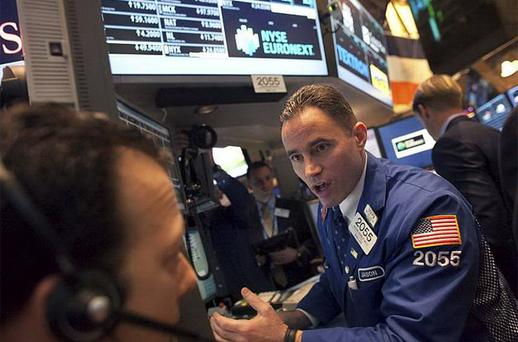 Traders work the floor at the New York Stock Exchange. Photo: Reuters