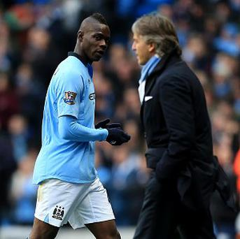 Roberto Mancini, right, insists he has faith in his striker Mario Balotelli