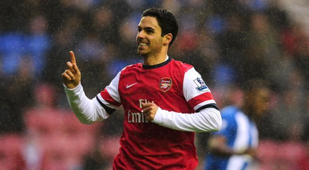 Arsenal's Mikel Arteta celebrates scoring their first goal of the game from the penalty spot during the Barclays Premier League match at the DW Stadium, Wigan. PRESS ASSOCIATION Photo. Picture date: Saturday December 22, 2012. See PA story SOCCER Wigan. Photo credit should read: Anna Gowthorpe/PA Wire. RESTRICTIONS: Editorial use only. Maximum 45 images during a match. No video emulation or promotion as 'live'. No use in games, competitions, merchandise, betting or single club/player services. No use with unofficial audio, video, data, fixtures or club/league logos.