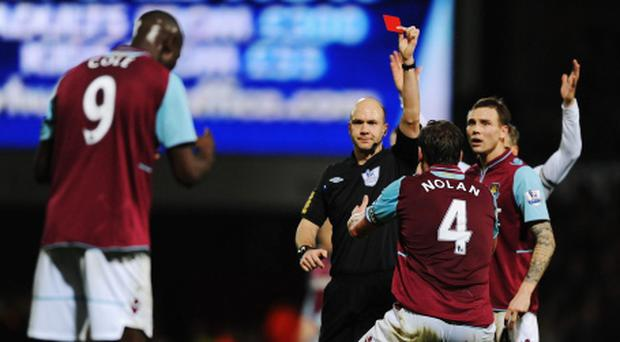 West Ham United players react as match referee Anthony Taylor sends off Carlton Cole. Photo: Getty