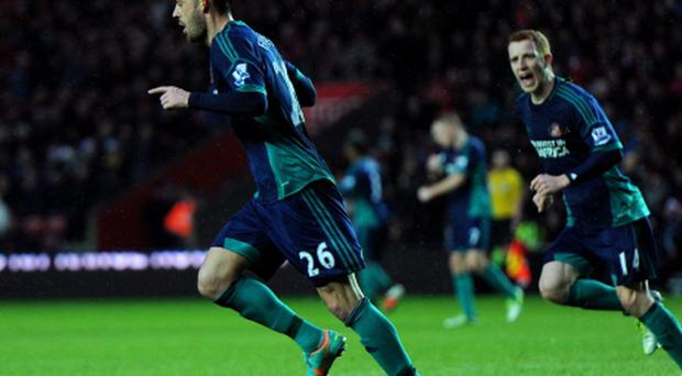 SOUTHAMPTON, ENGLAND - DECEMBER 22: Steven Fletcher #26 of Sunderlannd turns away to celebrate with teammate Jack Colback after scoring his team's opening goal during the Barclays Premier League match between Southampton and Sunderland at St Mary's Stadium on December 22, 2012 in Southampton, England. (Photo by Tom Dulat/Getty Images)