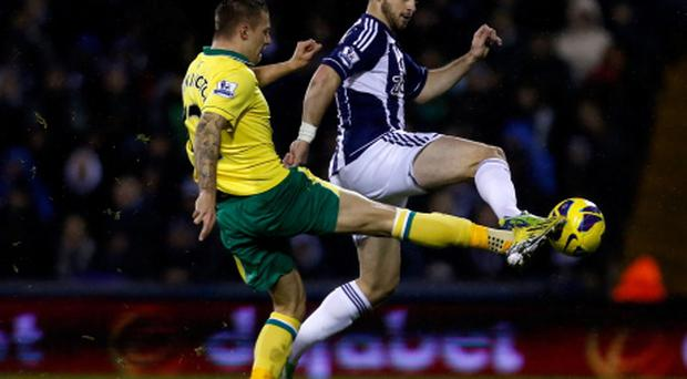 WEST BROMWICH, ENGLAND - DECEMBER 22: Anthony Pilkington of Norwich City tackles Shane Long of West Bromwich Albion during the Barclays Premier League Match between West Bromwich Albion and Norwich City at The Hawthorns on December 22, 2012 in West Bromwich, England. (Photo by Paul Thomas/Getty Images)