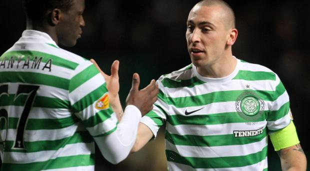 Celtic's Scott Brown (right) celebrates the first goal with Victor Wanyama during the Clydesdale Bank Scottish Premier League match at Celtic Park, Glasgow. PRESS ASSOCIATION Photo. Picture date: Saturday December 22, 2012. Photo credit should read: Lynne Cameron/PA Wire. EDITORIAL USE ONLY.