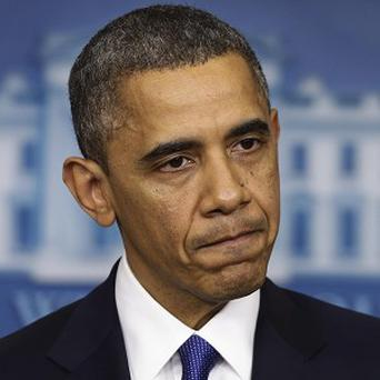 Barack Obama speaks to reporters about the fiscal cliff in the White House (AP/Charles Dharapak)