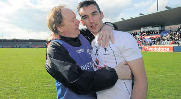 Willie Sunderland congratulates Martin Fitzgerald after Kildare won the Allianz Hurling League Division 2B final in April