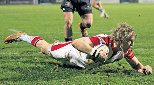 Andrew Trimble dives over for Ulster's third try against Leinster on Friday night.