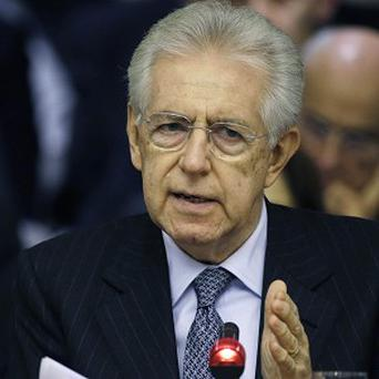 Italian premier Mario Monti said he would not run a ticket with Silvio Berlusconi (AP Photo/Gregorio Borgia)