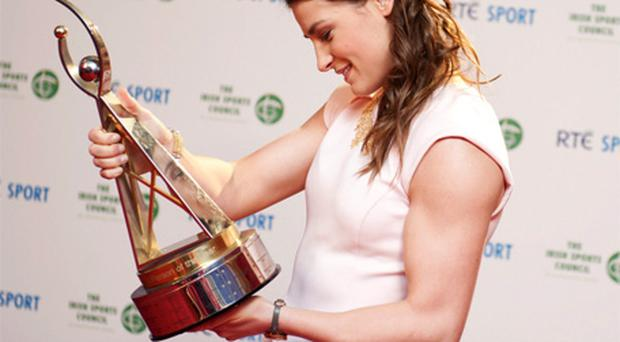 Boxer Katie Taylor looks at her trophy after being named RTE Sports Person of the year