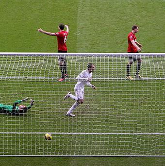 Michu, second right, maintained his inmpressive form as Swansea held Manchester United