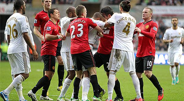 Ashley Williams and Robin van Persie clash and a Sky Sports video grab of the controversial incident